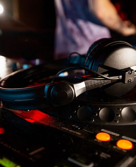dj-has-break-music-session-close-up-photo-disk-jockey-console-turntables-with-headphones-laying-top-it-mixing-equipment-club-life-concept